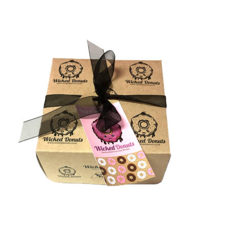 donut gift box with ribbon and tag